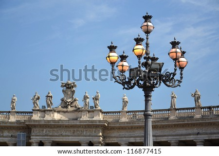 Statues and Vatican symbol at Saint Peter's Square in Vatican - stock photo