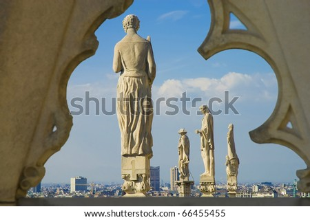 Statues at the roof of Il Duomo di Milano, the fourth-largest church in the world. - stock photo