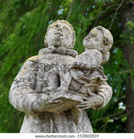 Statues near a Roman Catholic church of the Exaltation of the Holy and St. Joseph. Pidhirtsi Castle, Lviv region, Ukraine.  - stock photo