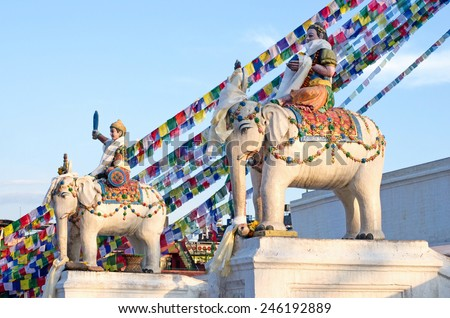 Statues near Buddhist Boudhanath Stupa in Kathmandu, Nepal  - stock photo