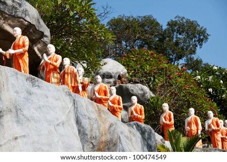 Statues of Buddhist Monks at the Rock Temple  Dambulla, Sri Lanka - stock photo