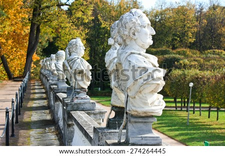 Statues of emperors in the autumn park - stock photo