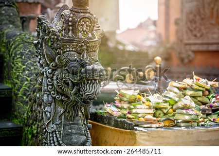 Statues of Hindu God or demons with offerings, Bali, Indonesia - stock photo