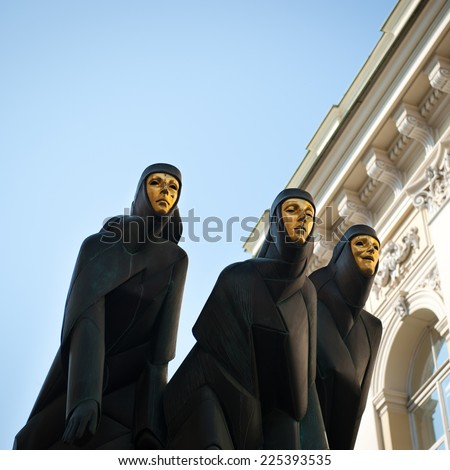 Statues of Lithuanian National Drama Theater in Vilnius, Lithuania, Europe. National Drama Theater located on Gediminas Avenue in Vilnius, is one of the biggest theatres in Lithuania. Founded in 1940. - stock photo