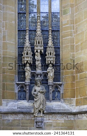 Statues of saints on the wall of Saint Jacob Church, lutheran in the Rothenburg ob der Tauber, Germany  - stock photo