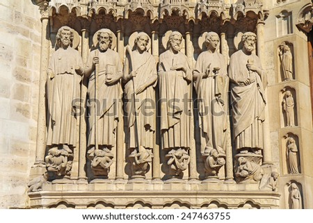 Statues of six apostles to the left side of the Portal of the Last Judgment on the west facade of the Cathedral of Notre Dame in Paris, France