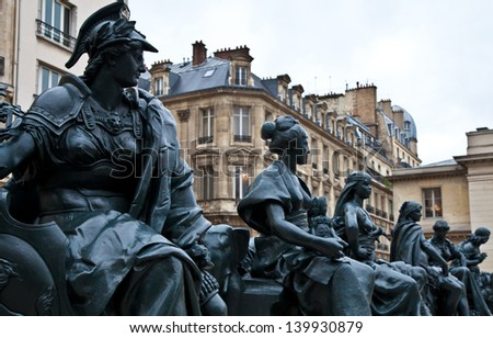 Statues of six continets in front of Orsay Museum - stock photo