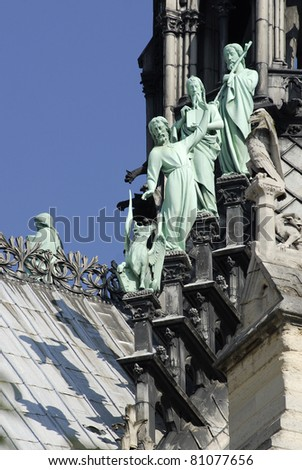 statues of the apostles of Saint Luke at the base of the spire of the cathedral Notre Dame in Paris - stock photo