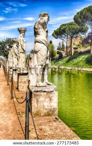 Statues of the Caryatides overlooking the ancient pool called Canopus at Villa Adriana (Hadrian's Villa), Tivoli, Italy - stock photo