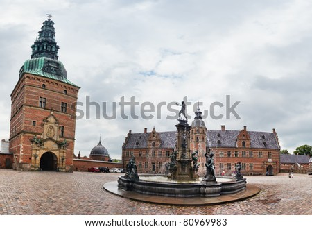Statues on the fountain at entrance to Frederiksborg Castle, Hillerod, Denmark - stock photo