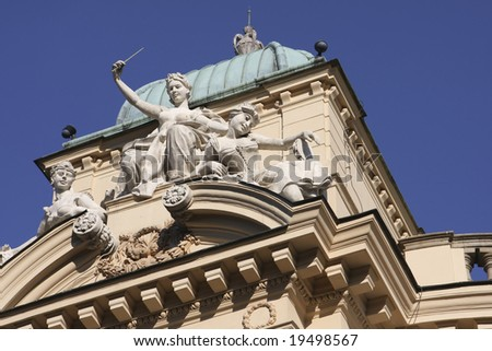 Statues on the Slowacki theater in Cracow, Poland (built 1892) - stock photo