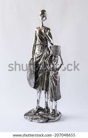 Statuette of a Woman and a Child  - stock photo