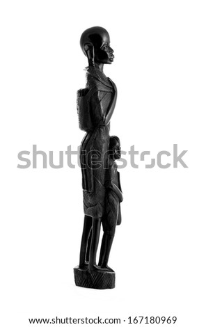 Statuette of a woman and a child the masai tribe curved from ebony - Tanzania (black and white) - stock photo