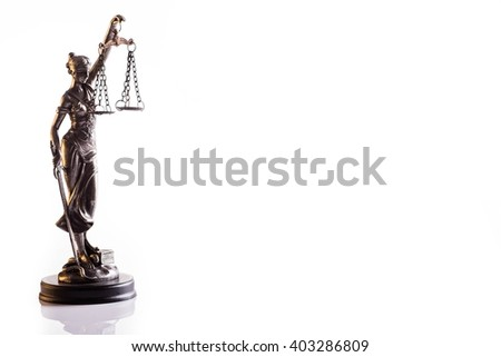 Statuette of the goddess of justice Themis with scales - isolated on white background. Law concept