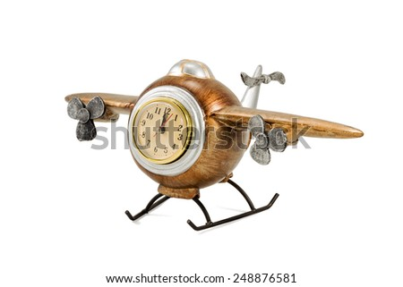 Statuette of vintage airplane with clock isolated on white background - stock photo
