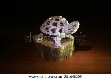 statuette turtle - stock photo