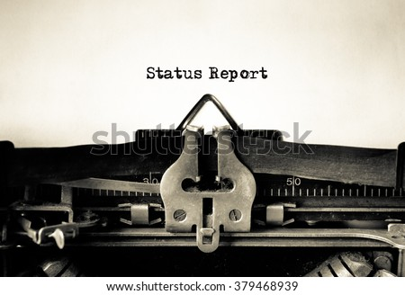 Status Report message typed on vintage typewriter  - stock photo