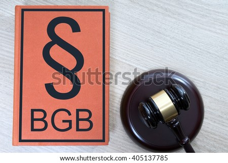 statute book and judges gavel with the letters BGB / Statute book - stock photo