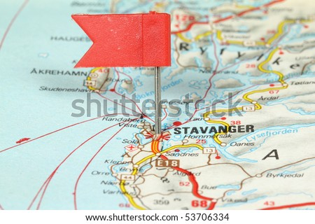Stavanger - famous city in Norway. Red flag pin on an old map showing travel destination. - stock photo