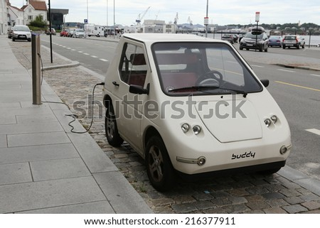 Stavanger, Norway- 29 July 2014. electric car charging in the city center. - stock photo