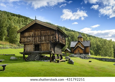Stave church in Norway and old wooden house.