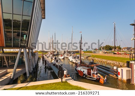 STAVOREN, THE NETHERLANDS - SEPTEMBER 4, 2014: Sailing boats waiting in a sluice before entering the IJselmeer in Stavoren in the province of Friesland, The Netherlands