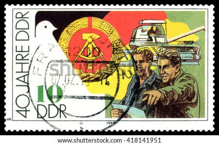 STAVROPOL, RUSSIA - APRIL 28, 2016: a stamp printed by GDR shows  Harvestler and farmers, 40 years of the GDR, circa 1989 - stock photo