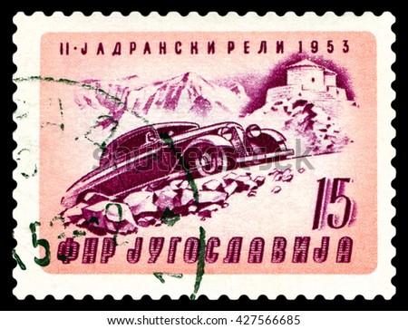 STAVROPOL, RUSSIA - MARCH 30, 2016: a stamp printed in Jugoslavia, shows  rally car. Automobile Climbing Mt. Lovcen, cirka 1953 - stock photo