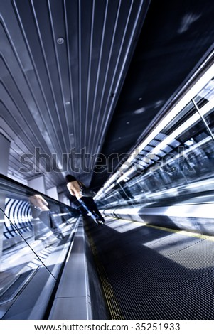 Staying on moving escalator on the way to Moscow city, diagonal view - stock photo