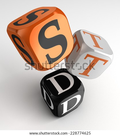 STD (Sexually transmitted diseases) sign on orange, white and black box cubes. clipping path included - stock photo