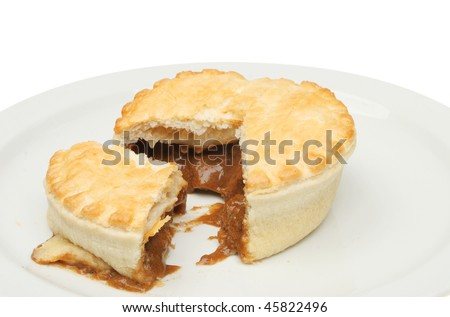Steak and ale meat pie on a plate - stock photo