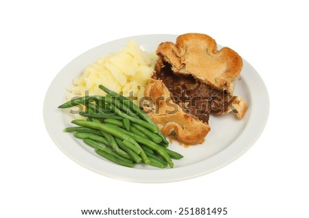 Steak and gravy pie with mashed potato and green beans on a plate isolated on white - stock photo