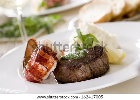 Steak and lobster with mashed potatoes. - stock photo