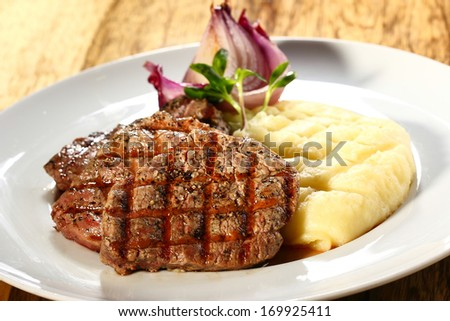 steak and mashed potatoes - stock photo