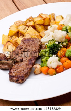 steak and vegetable plate - stock photo