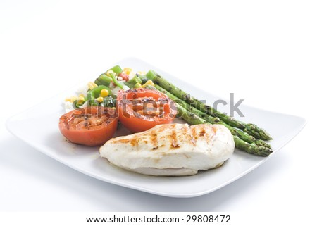 steak barbecued chicken with vegetables isolated ove white - stock photo