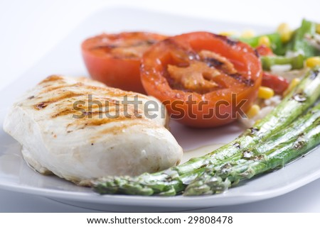 steak barbecued chicken with vegetables isolated ove white