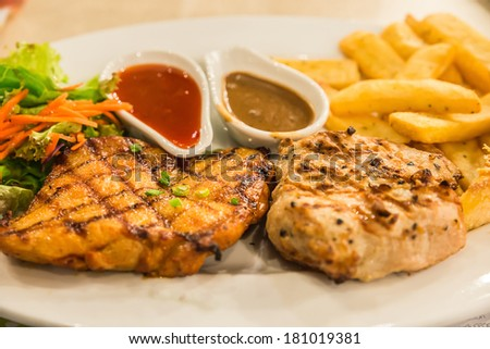 Steak, BBQ Pork and Spicy Chicken with FrenchFries