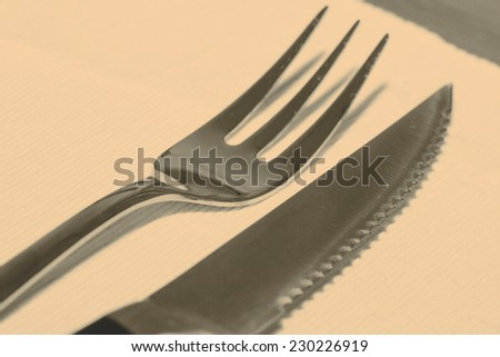 Steak cuttlery - fork and knife on the table - stock photo