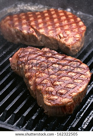 steak flame broiled on a barbecue - stock photo