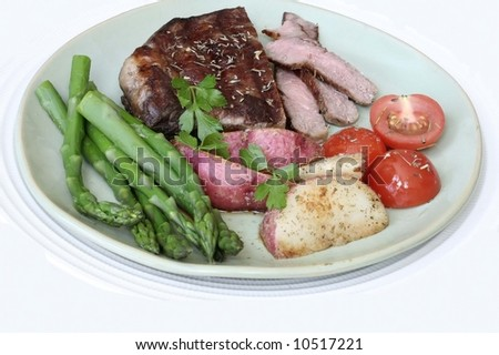 Steak,greenbeans,potatoes with tomato salad
