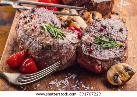 Steak. Grill beef steak. Portions thick beef juicy sirloin steaks on grill teflon pan or old wooden board. See the full set of 100 amazing photos - stock photo