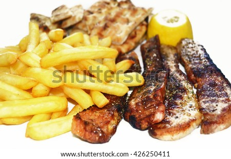 steak meat with fried potatoes and greek pita