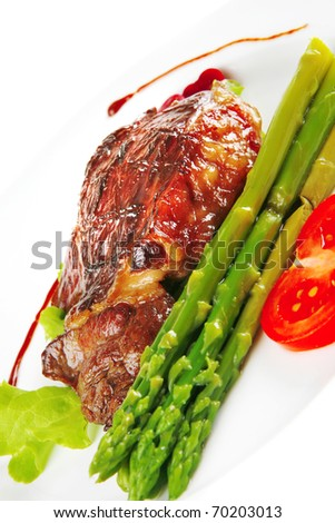 Steak Of Beef Meat Served On White Plate With Asparagus Isolated Over White Background Shallow