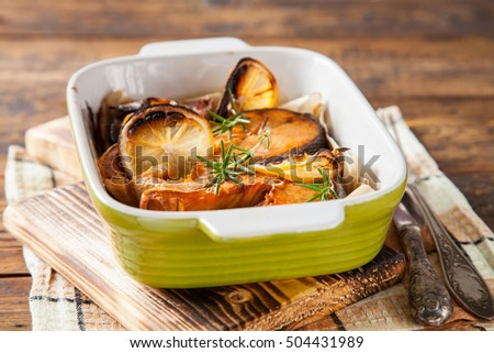 steak of red fish with  lemon and pepper in a bowl on a table, selective focus, copy space