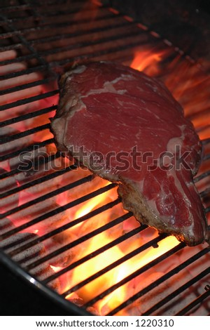 steak on a hot grill - stock photo