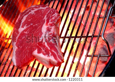 steak on a hot grill horizontal - stock photo
