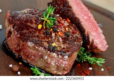 steak on wooden board - stock photo