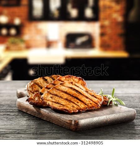 steak on wooden dark desk top and chicken space  - stock photo