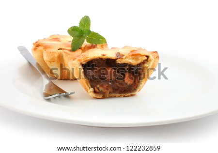 Steak pie sliced open isolated on white - stock photo